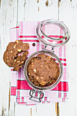 Chocolate cashew cookies in a glass jar