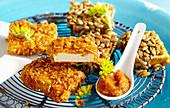 Panierte Tofu-Snacks mit Cornflakes und Sonnenblumenkernen