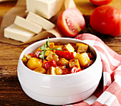 Tofu goulash with potatoes, peppers and tomatoes in a bowl