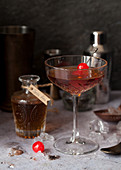 A Manhattan Cocktail and a Bottle of Tonka Bean Syrup