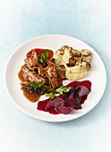 Pulled pork 'wild style' with mushroom polenta and beetroot