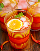 Summer drinks with orange slices and ice cubes in glasses