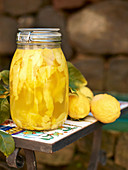 Homemade limoncello: lemon peel in vodka and sugar syrup