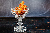 Savory cheese crackers in a glass