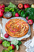 Apple pie made with sweet yeast dough, thin slices of apple and apricot jam