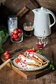 Crepes with strawberries and sour cream