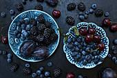 Various fruits on blue ceramic plates