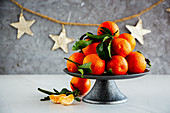 Ripe tangerines citrus fruits with leaves and Christmas decor