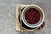 Organic ripe pomegranate fruit in bowl and knife