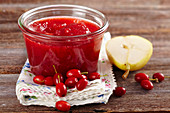 Homemade cornelian cherry and pear jam in a mason jar