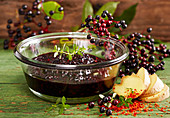 Homemade spicy elderberry compote with fresh ginger and chili