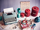Typewriter, kitchen utensils and nostalgic pictures