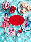 Paper doll and nostalgic kitchen accessories around red label
