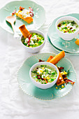 Pea soup with ricotta and diced bacon
