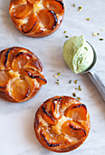 Three apricot flans with pistachio ice cream