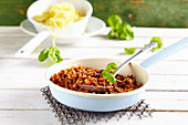Classic bolognese sauce in a pan with a spoon