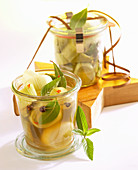 Leek in a honey marinade with mint in jars