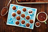 Keto chocolate truffles with avocado and cocoa powder