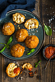 Arancini balls with mozzerella filling and tomato sauce