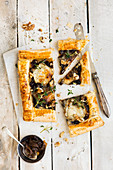 Goat's cheese and caramelised onion tart topped with walnuts and thyme