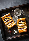 Halloween individual cherry pie mummies with edible eyes