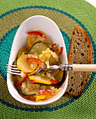 Pickled courgette salad from a jar with dark bread