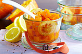 Pickled pumpkin compote with anise seeds and lemon in a jar