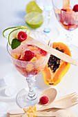 Non-alcoholic papaya and raspberry punch in glasses