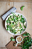 Rice salad with herbs, avocado, feta cheese and pine nuts