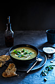 Curried parsnip and coriander soup with mint yoghurt and garlic flatbread