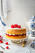 Victoria sponge with buttercream icing, raspberry jam and fresh raspberries