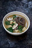 Miso soup with buckwheat noodles, spinach and tofu (Japan)