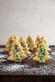 Iced Christmas tree biscuits decorated with sugar pearls