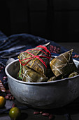 Zongzi (bamboo leaves filled with sticky rice, China)