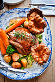 Roast beef with Yorkshire puddings and vegetables (England)
