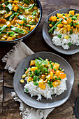 Vegetarian pumpkin and pea curry with rice