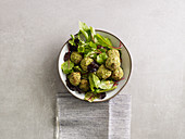 Broccoli and nut balls on a bed of salad (low carb)