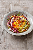 Fruity summer salad with mango, radicchio and peppers