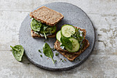 A green superfood sandwich with cucumber, avocado and spinach