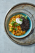 Sweet potato coconut curry with beluga lentils and sour cream