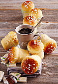Mini sweet bread rolls made in jars with sugar nibs and a cup of coffee for Easter