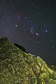 Orion above Native American petroglyph