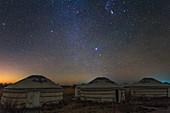Winter night sky over yurts in Inner Mongolia