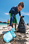 Collecting plastic waste on a beach