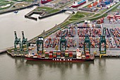 Barge loading shipping containers, aerial photograph
