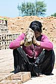 Mud brick industry worker