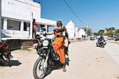 Motorbike rider by Indian temples