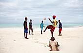 Football training on a beach, Zanzibar