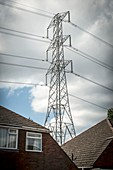 Power lines passing close to houses