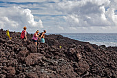Hikers on lava flow from Kilauea volcano eruption
